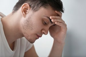 man with headache has substance use disorder